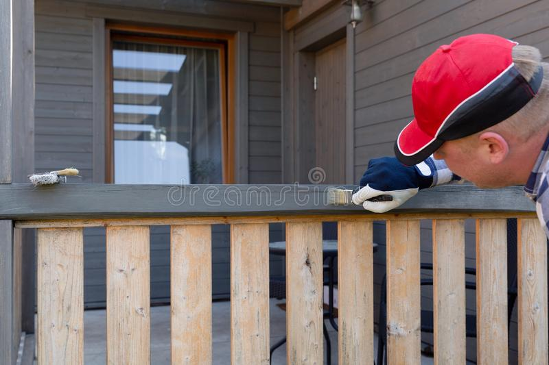 Painting terrace railings, home improvement, garden works. royalty free stock images