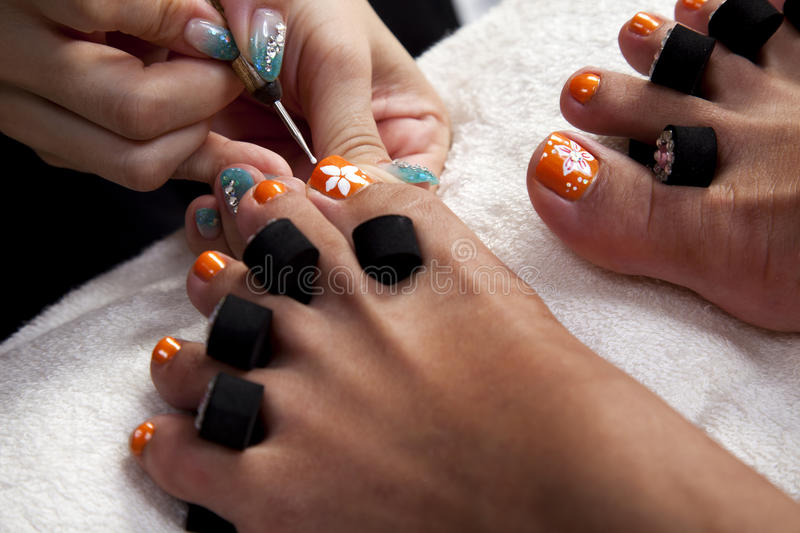 Painting toe nails royalty free stock images