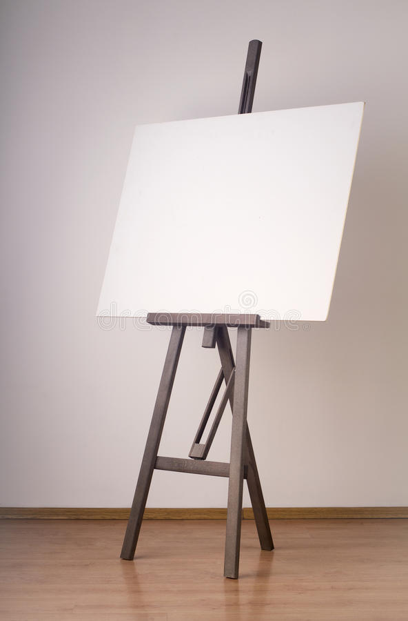 Painting tripod with empty cardboard stock photos