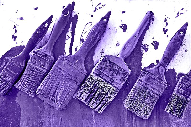 Paint Brushes. Ultra violet paint brushes concept painting wall royalty free stock photos