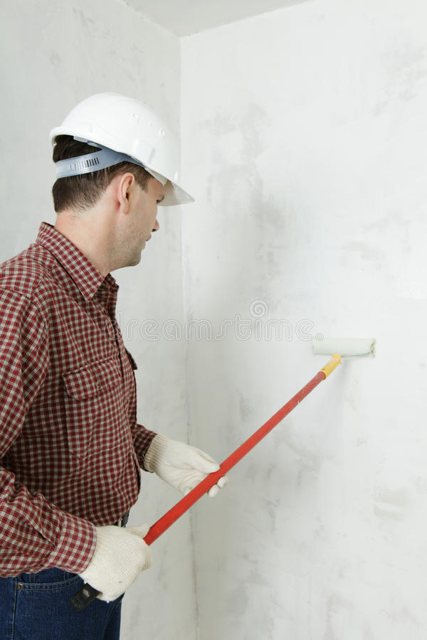 Painting the wall royalty free stock photos