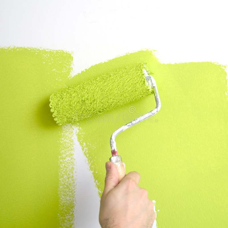 Painting a wall stock images