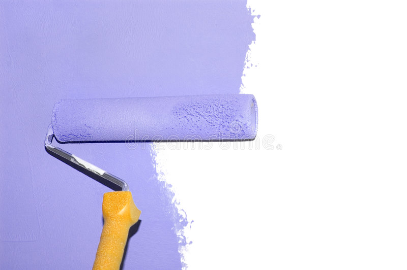 Painting a wall with a roll isolated royalty free stock image