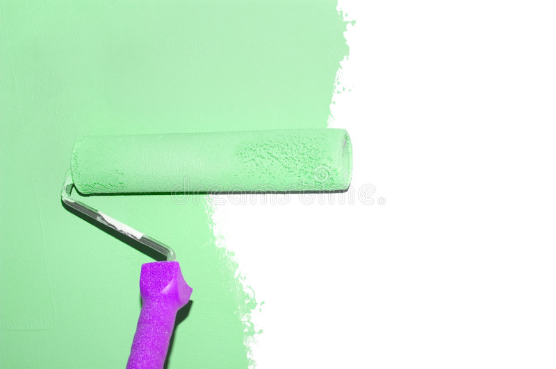 Painting a wall with a roll isolated stock photography