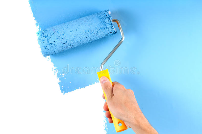 Painting wall with roller stock photos