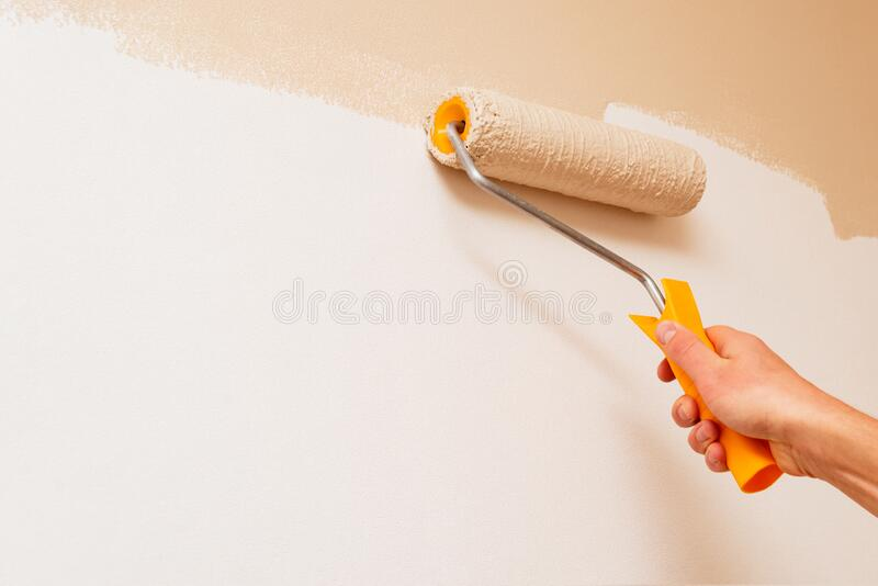 Painting the walls of a room royalty free stock photography