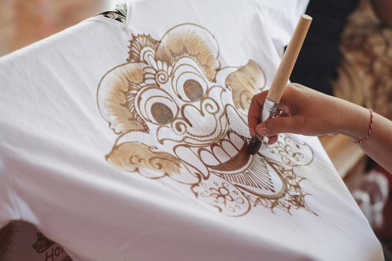 Painting watercolor on the fabric to make Batik Batik-making is part of Indonesian stock photos