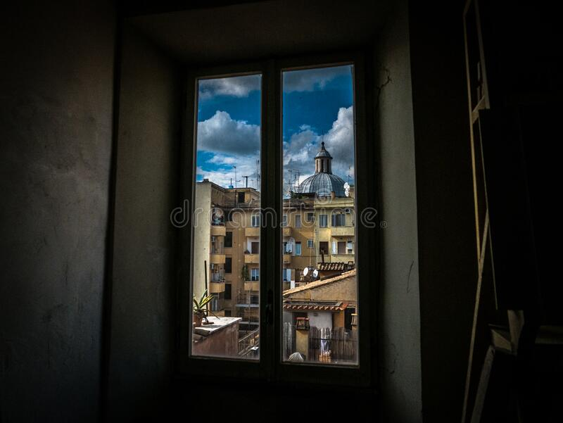 Painting of Window With View of Brown Buildings stock photos