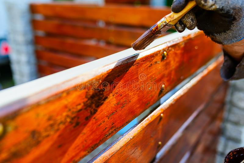 painting a wooden fence - a brush close-up, a very shallow depth royalty free stock images