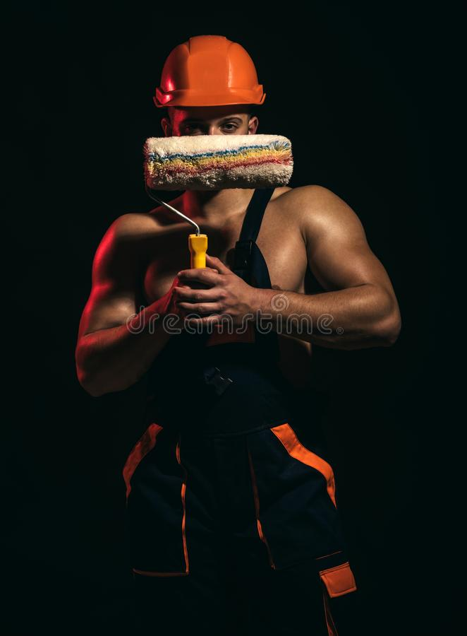 Painting that youll be proud of. Worker hold brush roller in muscular hands. Skilled painter or decorator man royalty free stock photography