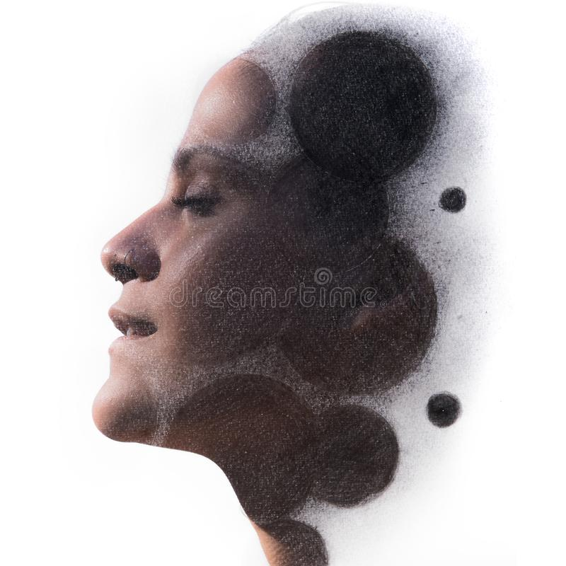 Paintography. Double Exposure charcoal drawing combined with portrait of a seductive woman with two nose piercings and relaxed d stock image