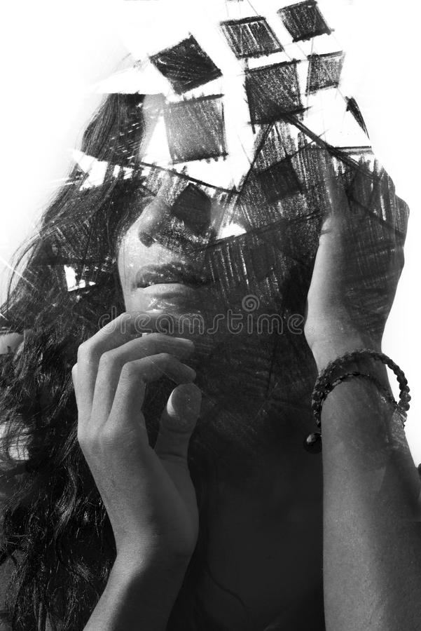 Paintography. Double Exposure charcoal drawing combined with portrait of a woman with strong features and expression, black and w royalty free stock images