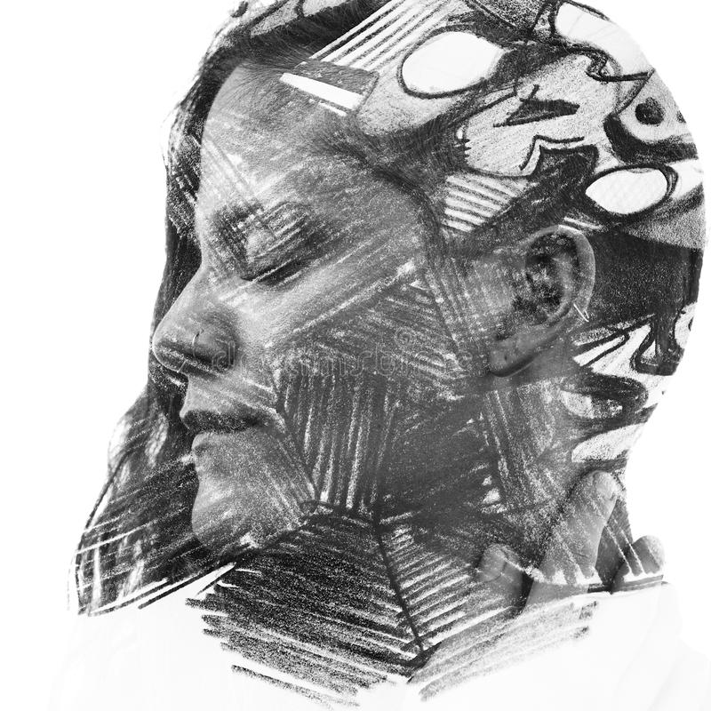 Paintography. Double Exposure charcoal drawing combined with portrait of a woman with strong features and expression, black and w stock photos