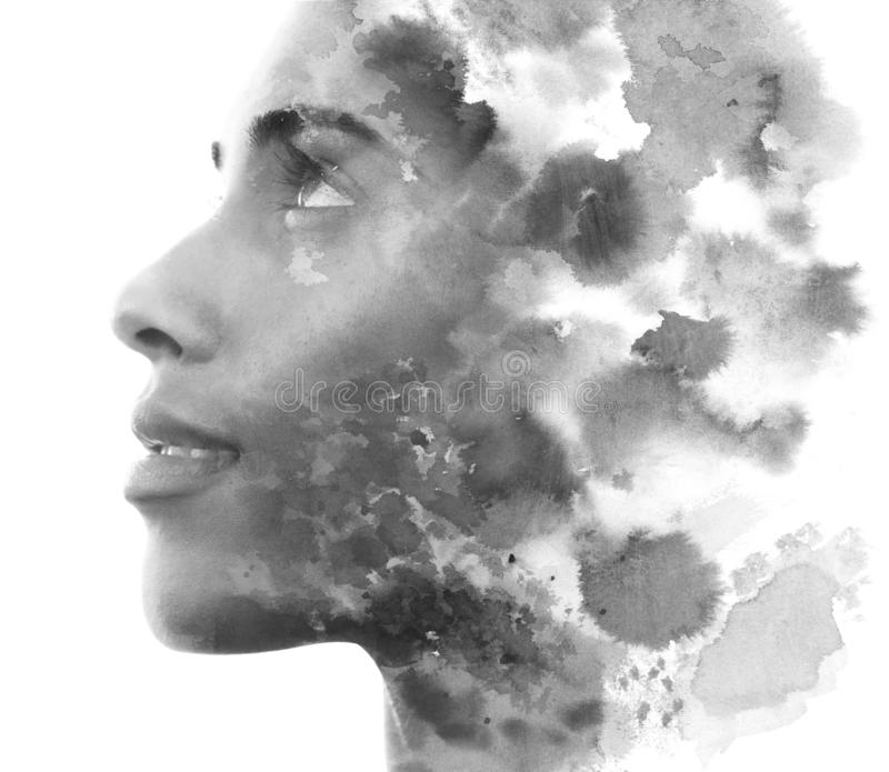 Paintography. Double exposure. Close up of an attractive model combined with hand drawn ink and watercolor painting with stock images