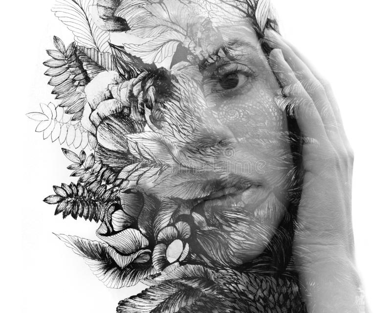 Paintography. Double exposure close up portrait of a young natural beauty, with face and hair combined with hand drawn leaves and stock photo