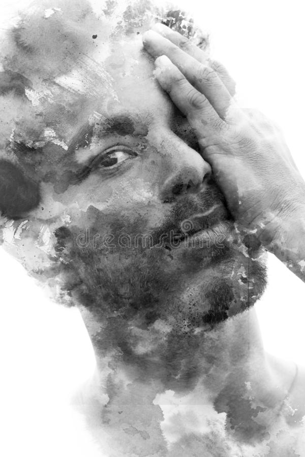Paintography. Double exposure of an attractive male model combined with hand drawn ink paintings with depth and texture, black and stock images