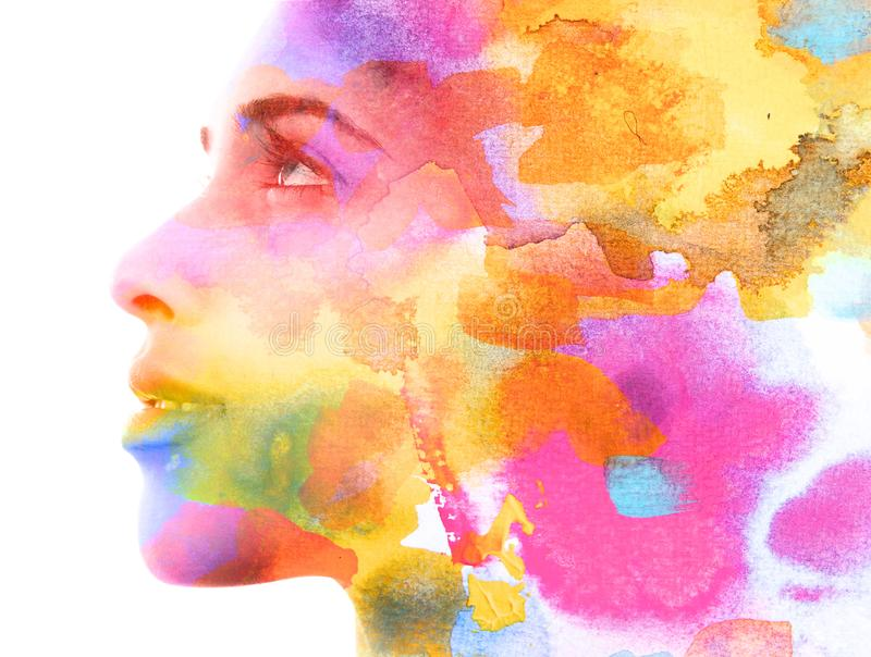 Paintography. Double exposure. Close up of an attractive model combined with colorful hand drawn ink and watercolor painting with royalty free illustration