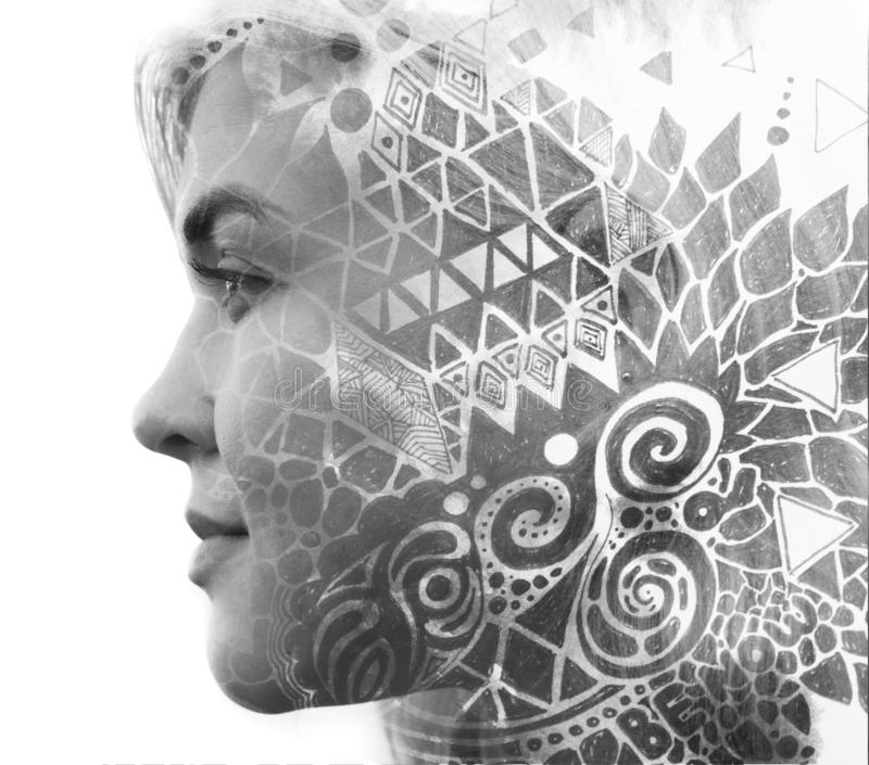 Paintography. Double Exposure portrait of a young beautiful woman combined with hand drawn ink painting using unique technique stock photography