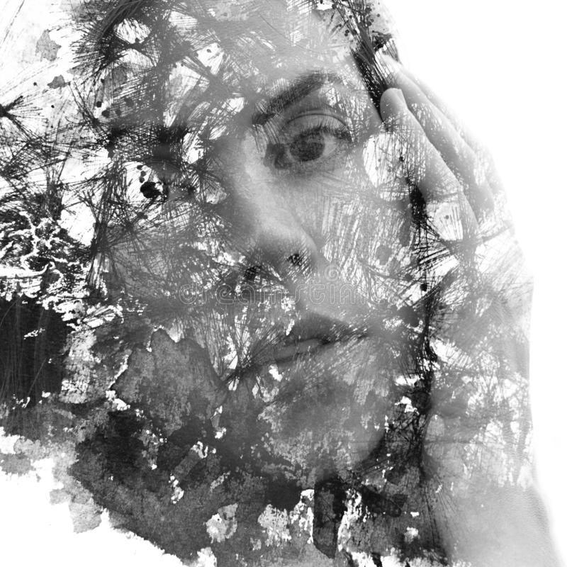 Paintography. Double Exposure portrait of a young beautiful woman with hand on face combined with hand drawn ink and pen drawing. Paintography. Double exposure stock photography
