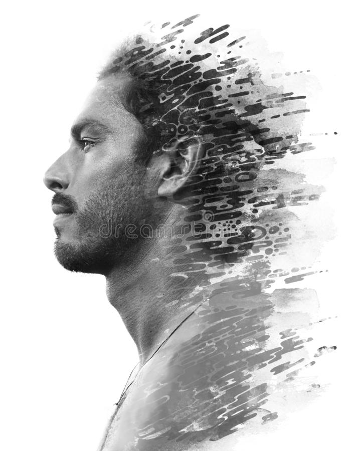 Paintography. Double exposure of a young male model combined with hand drawn painting of dissolving ink texture stock photography
