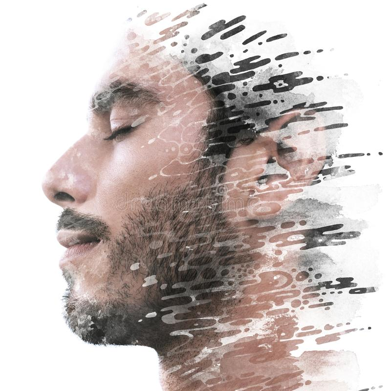 Paintography. Double exposure of a young male model combined with hand drawn painting of dissolving ink texture stock photo