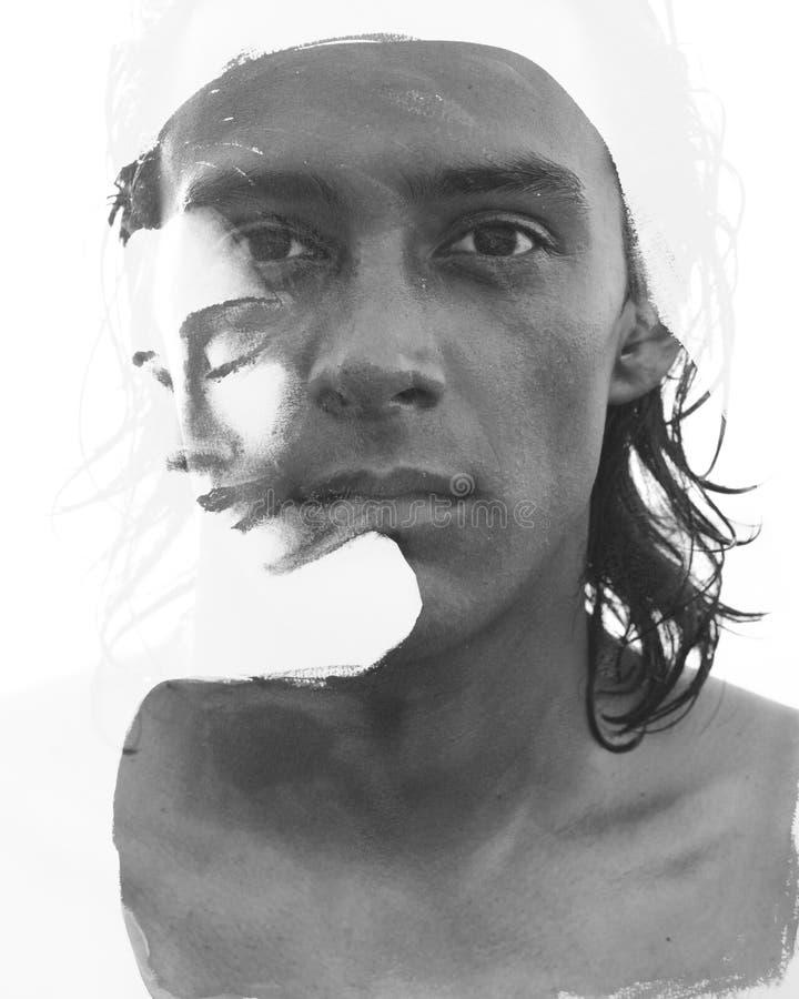 Paintography Dubbel blootstellingsportret van een jonge mens, peinzend y stock afbeelding