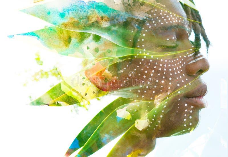 Paintography Dubbele blootstelling van een donkere gevilde mens met dreadlo royalty-vrije stock fotografie