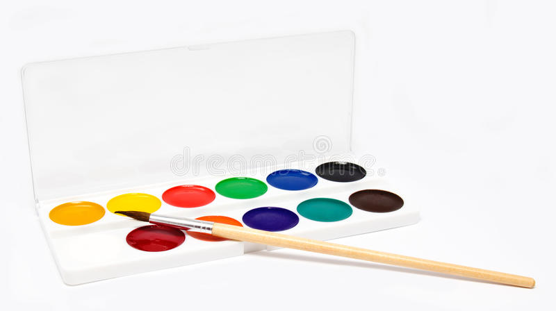 Paints and brush on a white