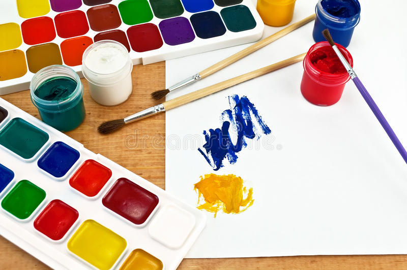Paints, brushes and gouache stock images