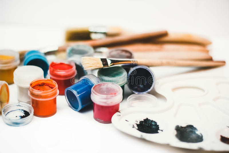 Paints, brushes and Palette of watercolor paints royalty free stock photography