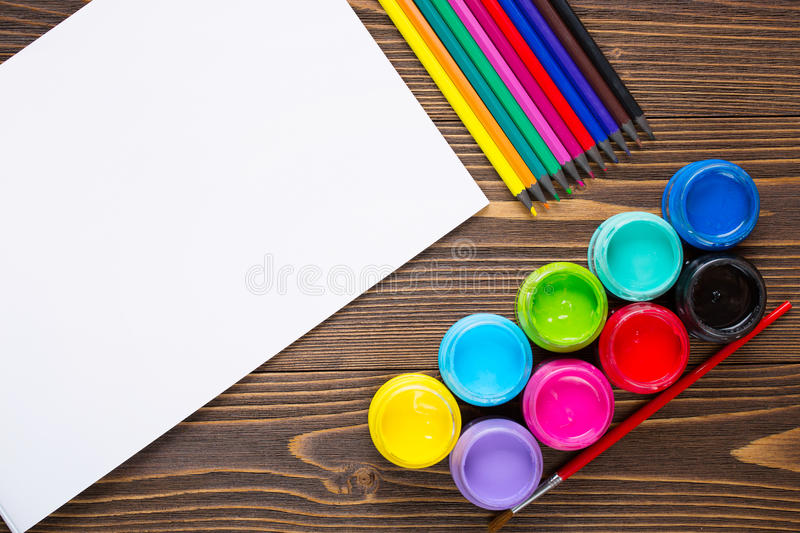 Paints, crayons, paper, painting sets royalty free stock images