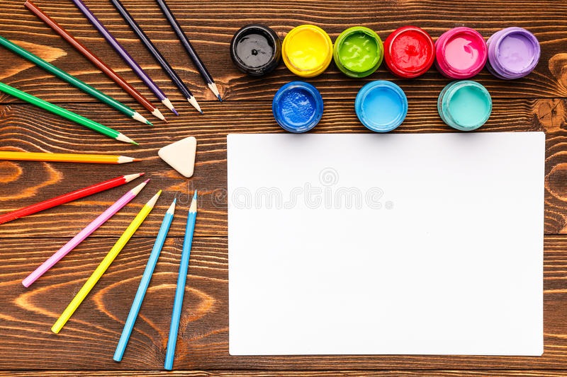 Paints, crayons, paper, painting sets royalty free stock photo