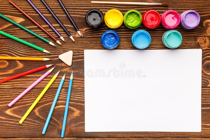 Paints, crayons, paper, painting sets stock image