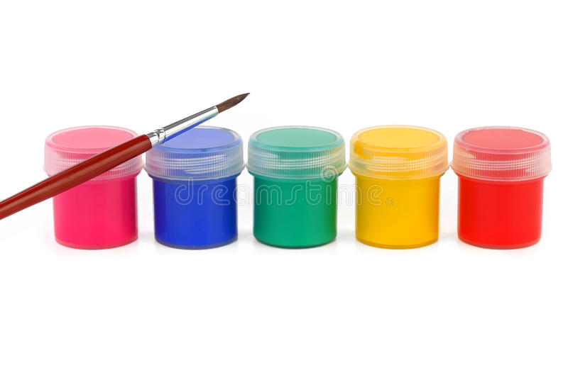Paints of different colors and slim paintbrush stock photo
