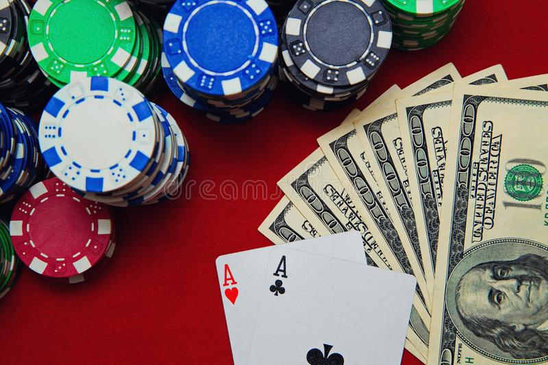 Pair of aces with dollars and poker chips royalty free stock photos
