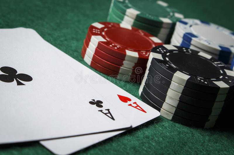 A pair of aces with a pile of poker chips royalty free stock photos