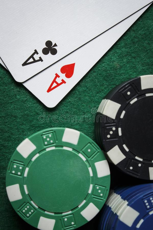 A pair of aces with a pile of poker chips stock images