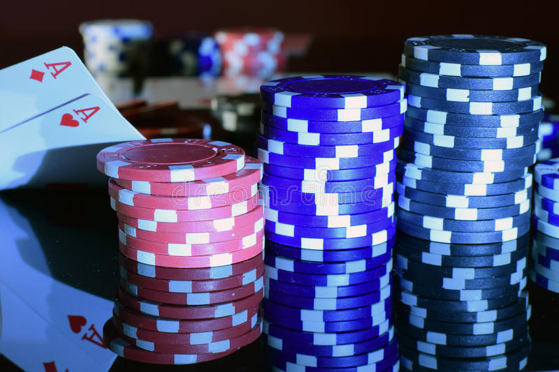 Pair of aces in pocket pair and poker chips. stock image
