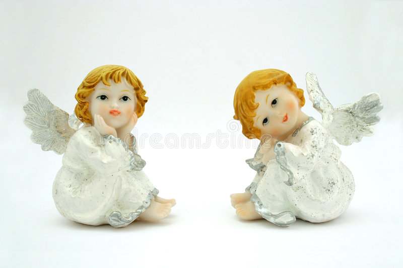A pair of angels. Photographed on a white background