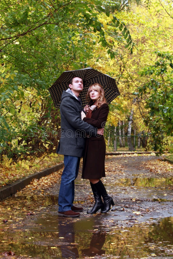 Pair in autumn park royalty free stock images