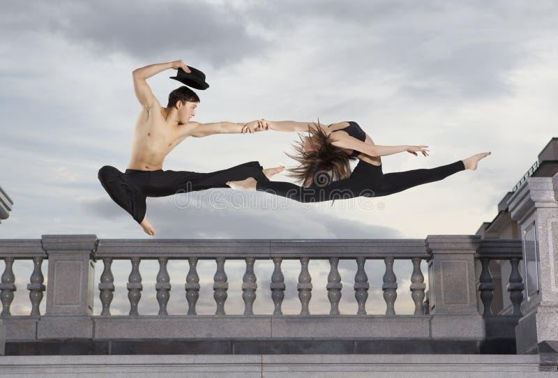 Pair ballet dancer series on sky stock image