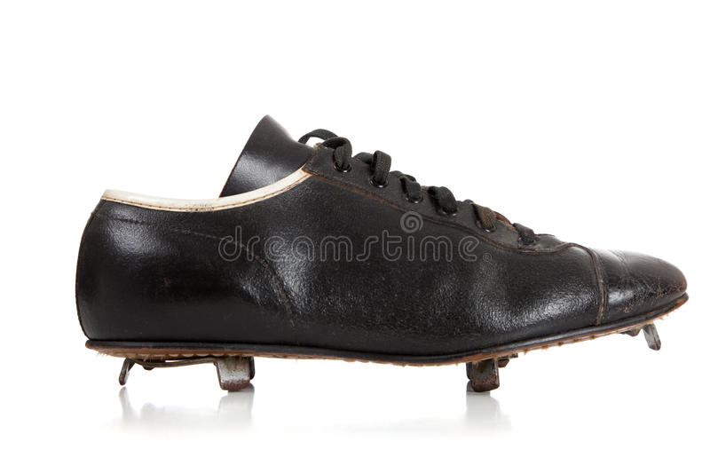 Pair of baseball cleats on white. A pair of baseball cleats on a white background royalty free stock photos