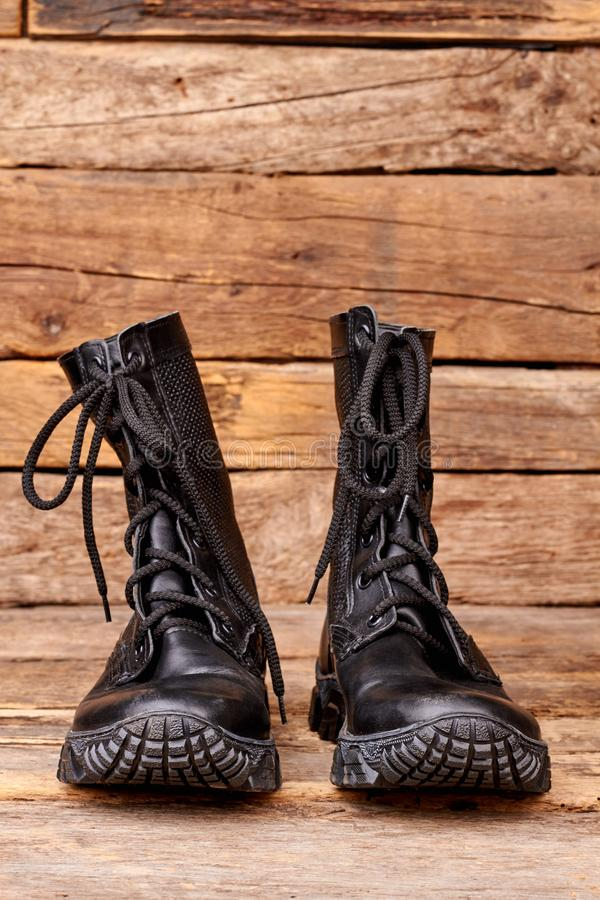 Pair black combat army boots. stock image