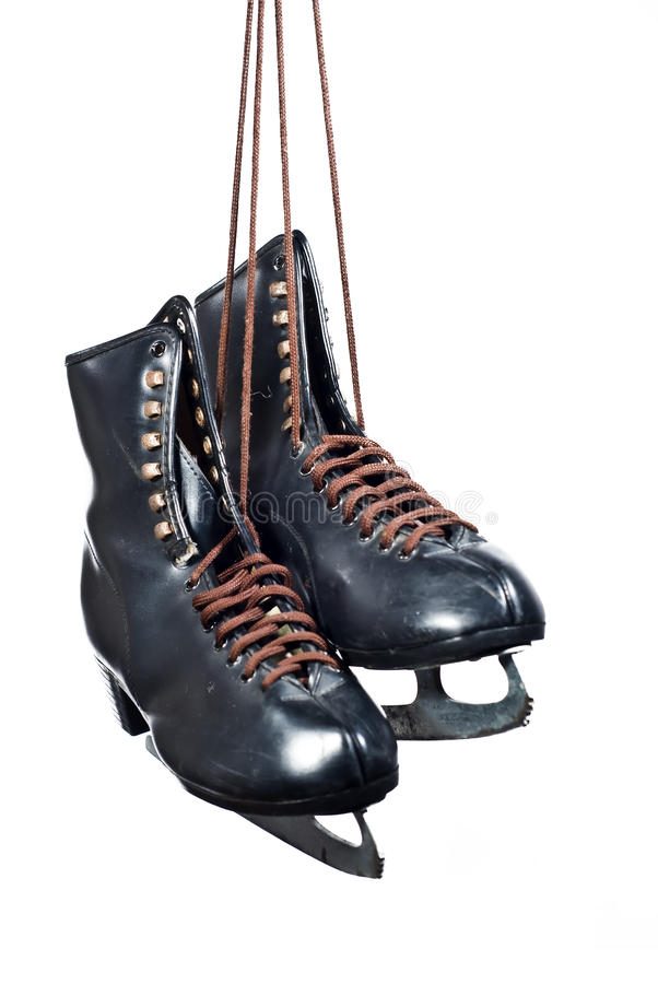 Pair of black figure skates hanging stock photography