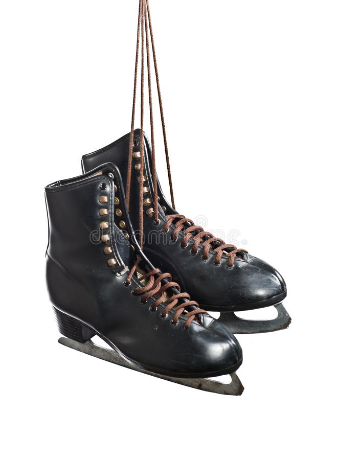 Pair of black figure skates hanging royalty free stock photography