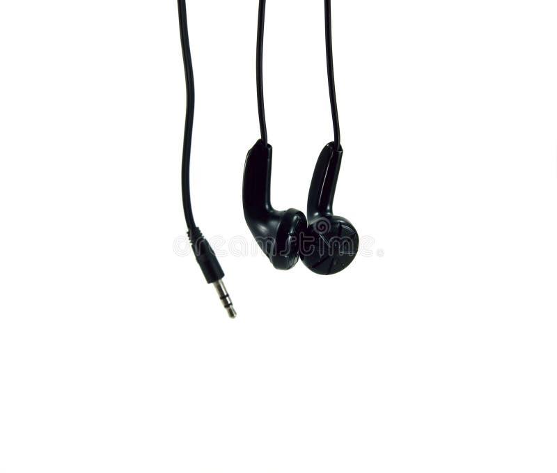 Pair of black headphones. A pair of black headphones stock photography