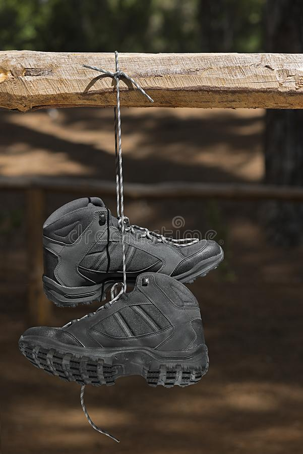 A pair of black hiking boots. In the forest at sunset stock images