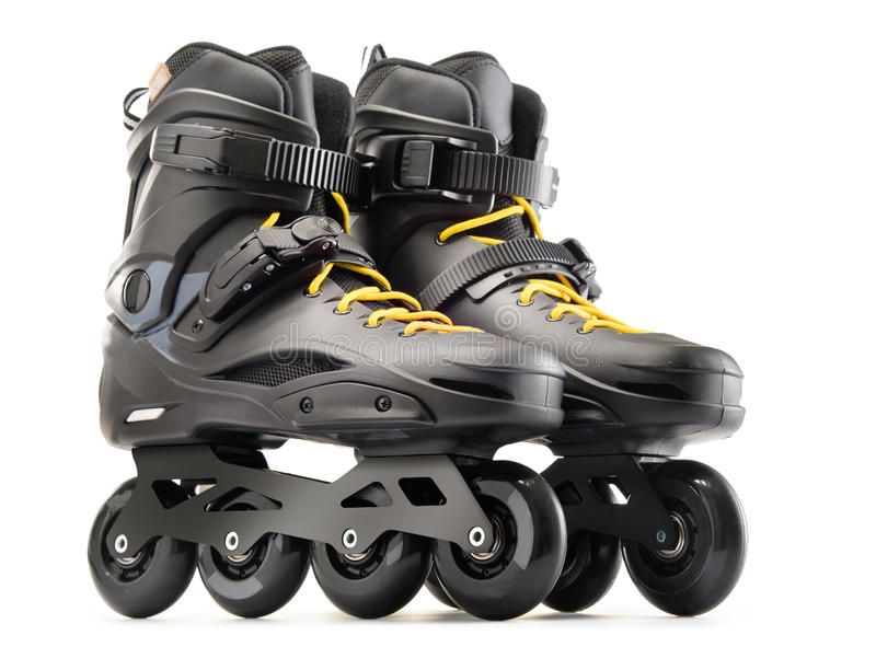 Pair of black inline skates isolated on white. Background stock images