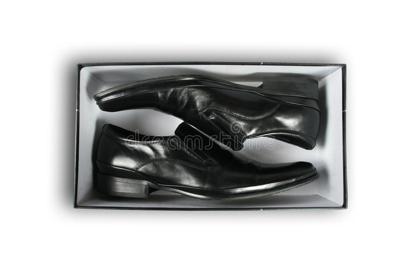 Pair of black leather shoes inside a box stock photography