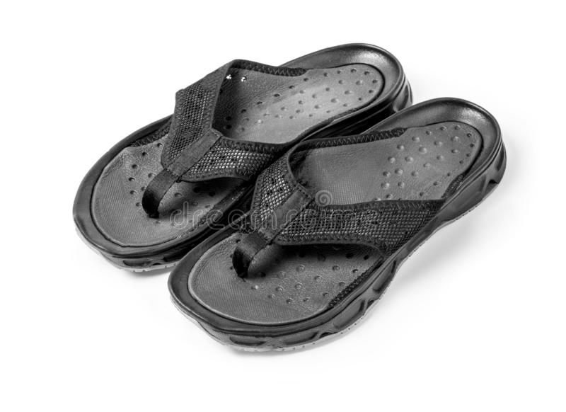 Pair of black mens flip flops isolated. On white with clipping path royalty free stock images